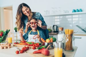 Mother and daughter making healthy food.