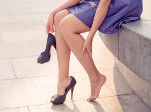 Woman grabbing leg