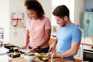 Couple preparing meals