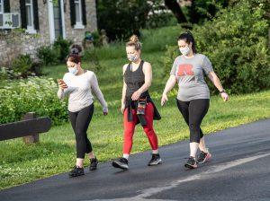 Women walking iwth masks