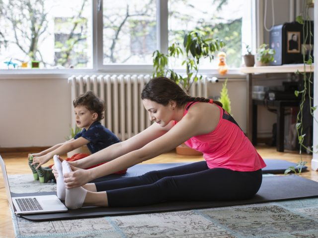 Woman and child stretching