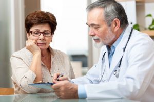 Doctor discussing medical information with patient