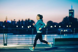 Woman running safely at night