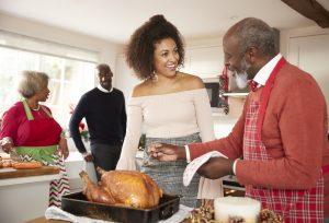 Older family making turkey dinner