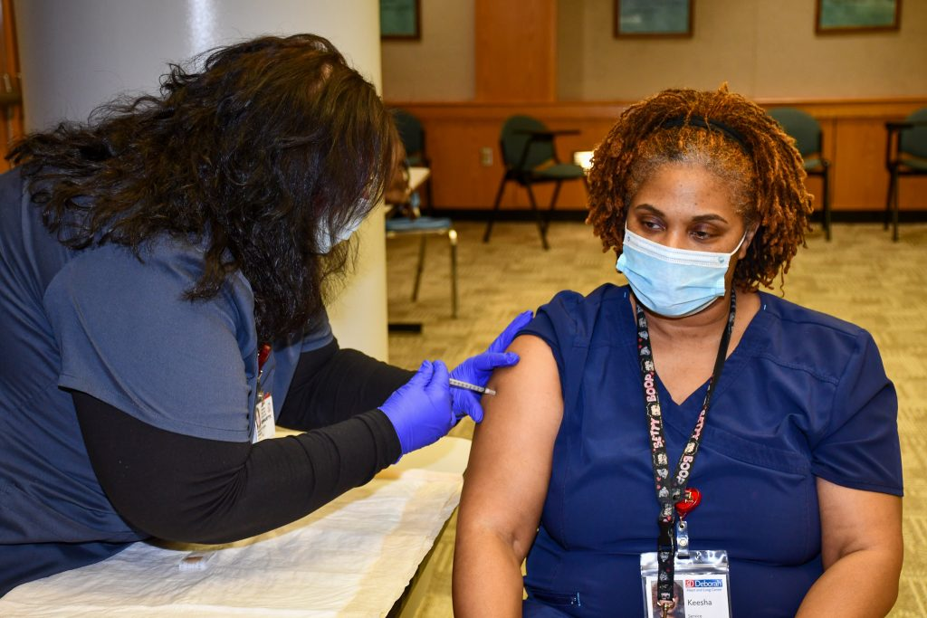 Environmental Services employee Keesha Wilburn receives her second vaccine dose.