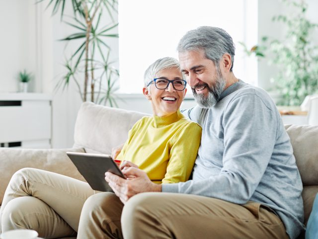 Couple watching tablet