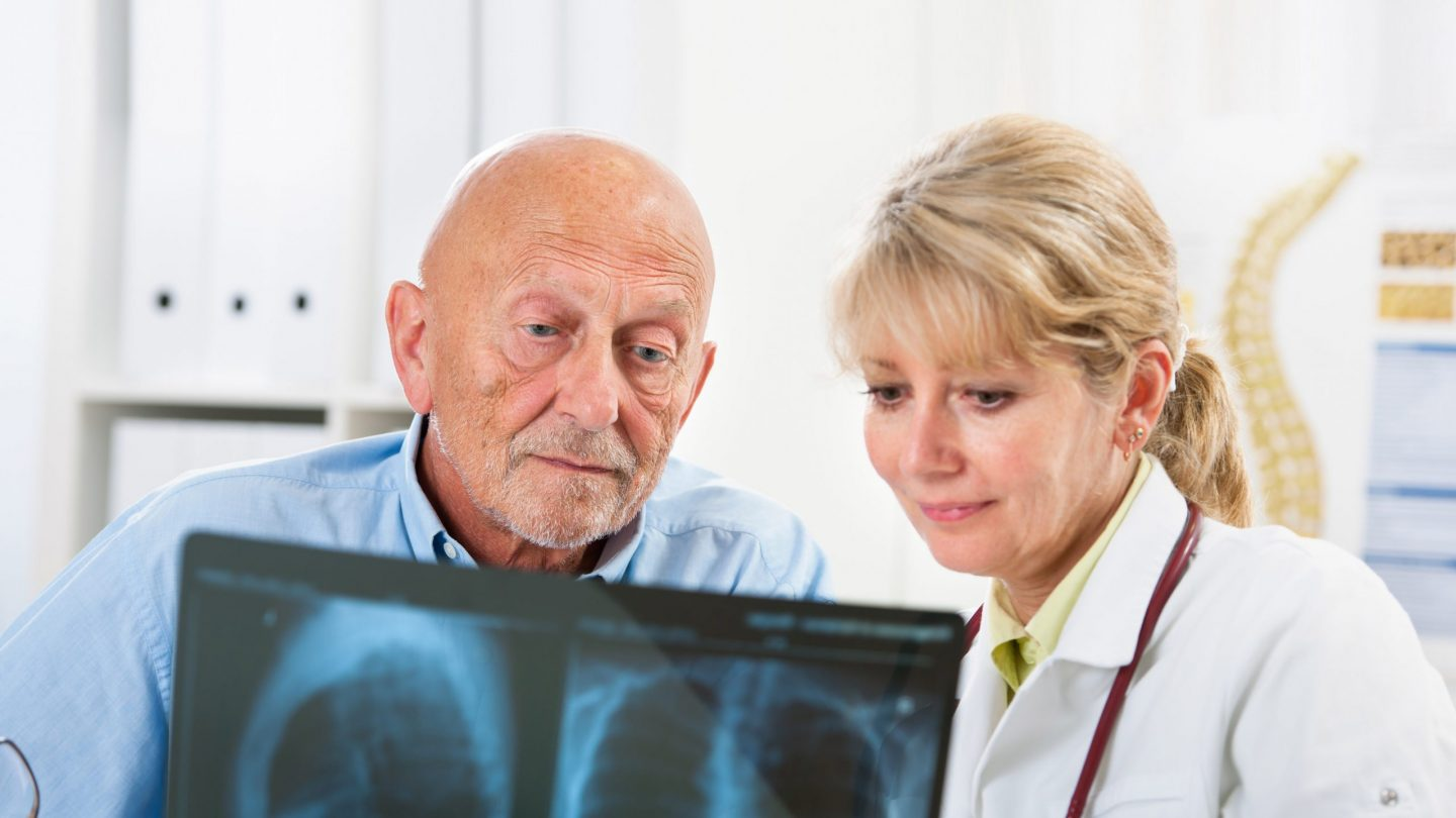 Lung Patient Examining X-Ray with Doctor