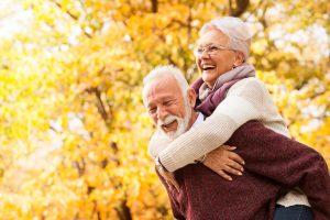 Senior couple embrace outside