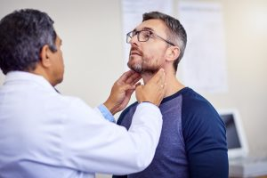 Doctor checking neck