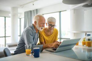 Mature couple on laptop
