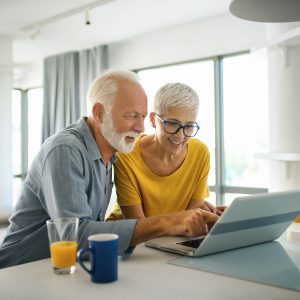Mature couple on laptop
