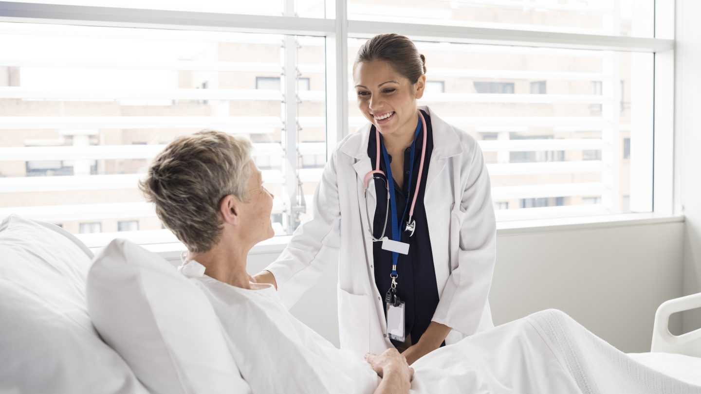 Female consultant smiling and talking with patient