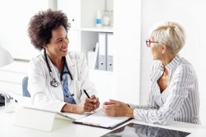 Mature woman talk with her doctor about health in clinic