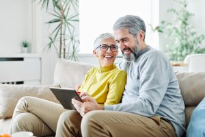 senior couple use tablet
