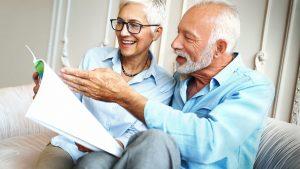 Happy senior couple reading