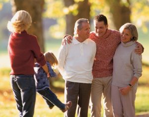 Multi generational family walking together outdoor in fall
