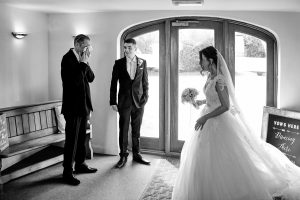 Father, bride and groom