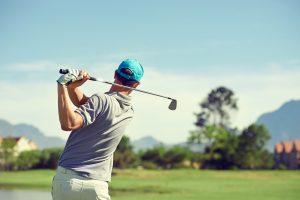 Golfer hitting golf shot