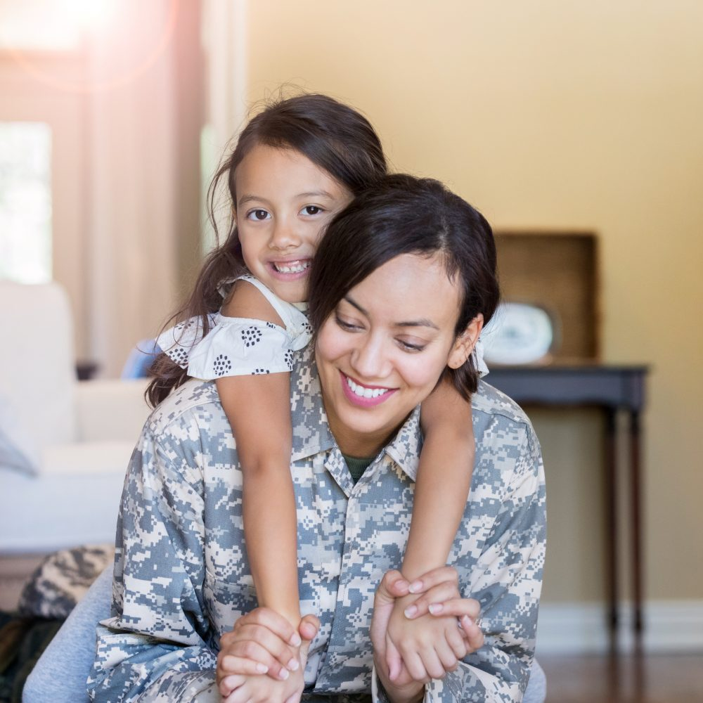 Military woman with daughter