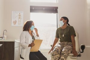 Female army soldier consults doctor